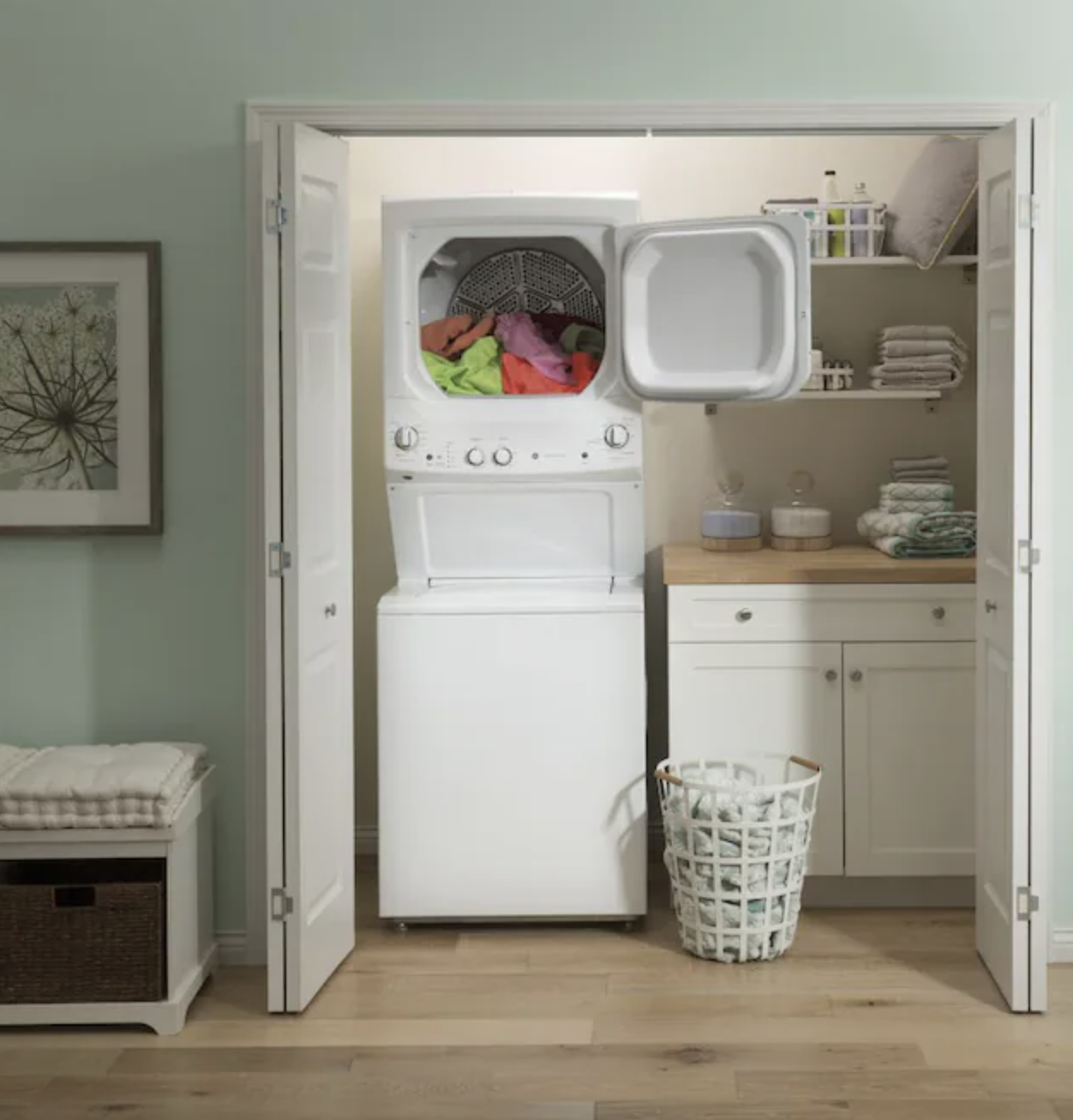 Stacked washer and dryer unit placed in laundry closet