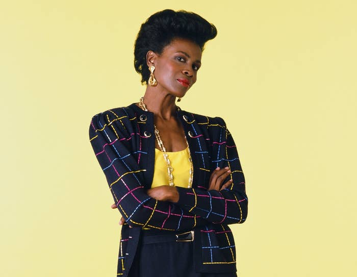 Janet stands with her arms crossed in a promo photo from Fresh Prince