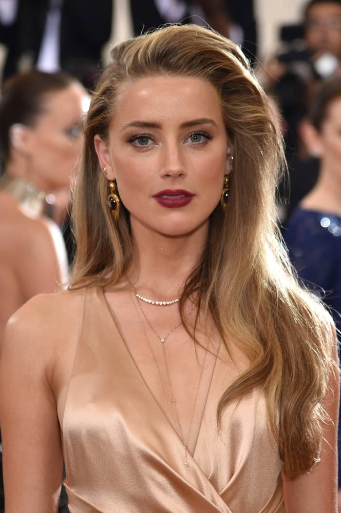 Amber Heard wears a dress and poses for the camera at the Met Gala in 2016