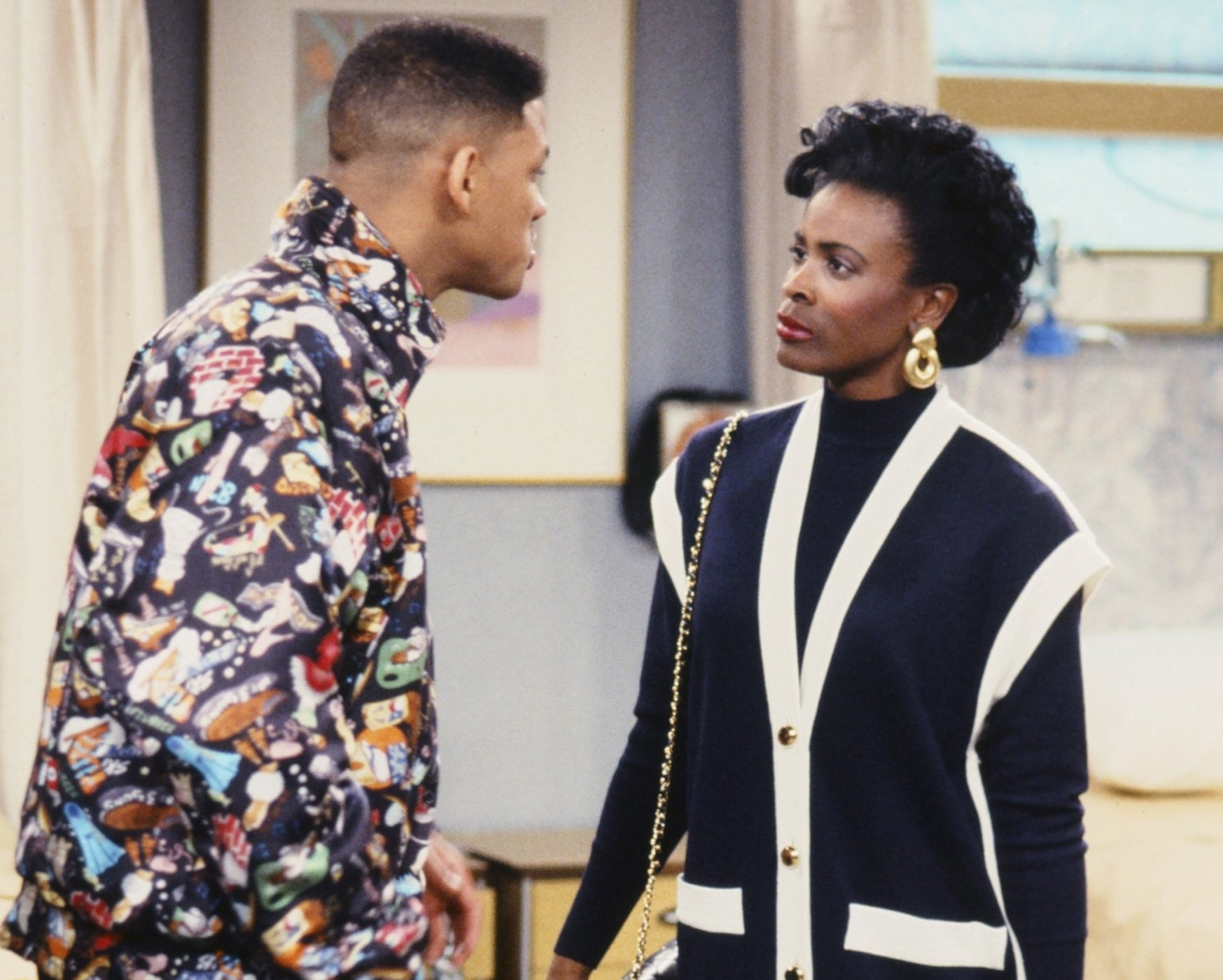Janet looks serious while glaring at Will Smith in a scene from Fresh Prince