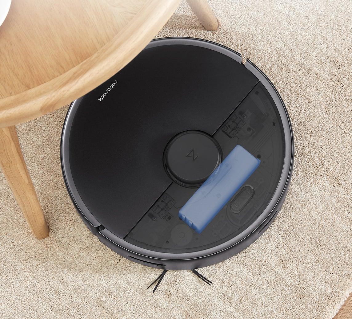 Roborock max robotic vacuum under a kitchen table