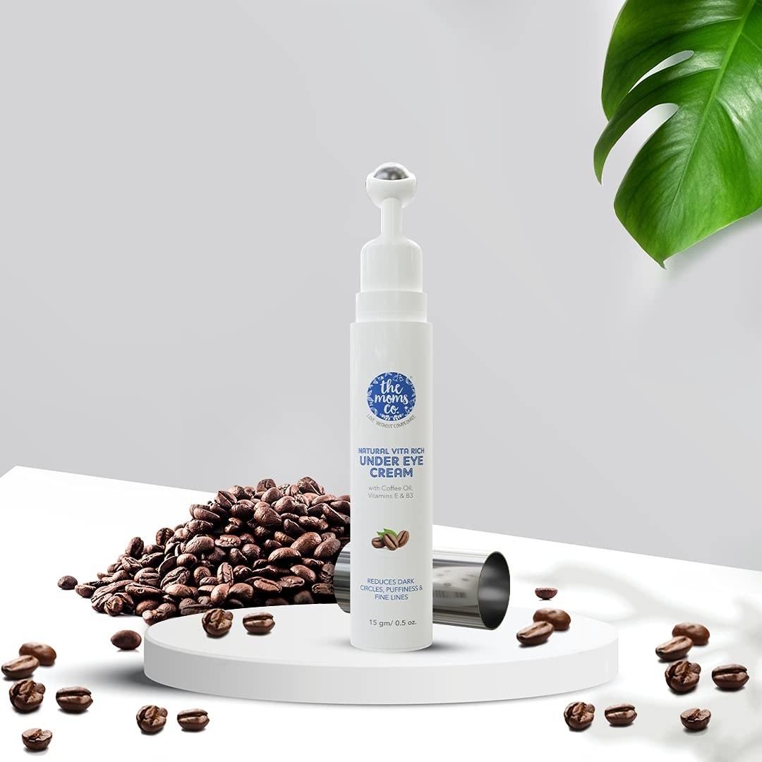 An under-eye cream beside coffee beans