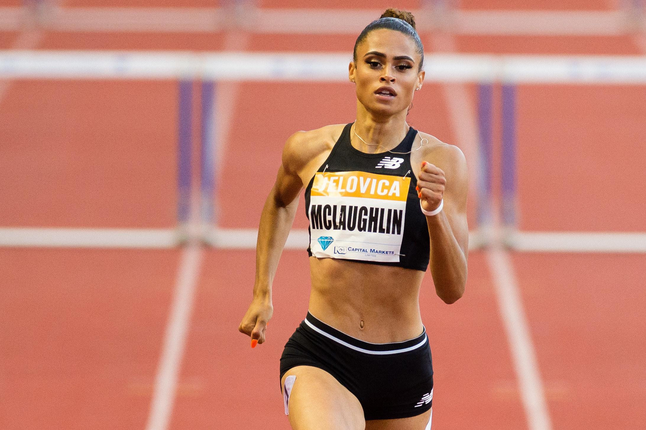 Sydney McLaughlin runs past hurdles