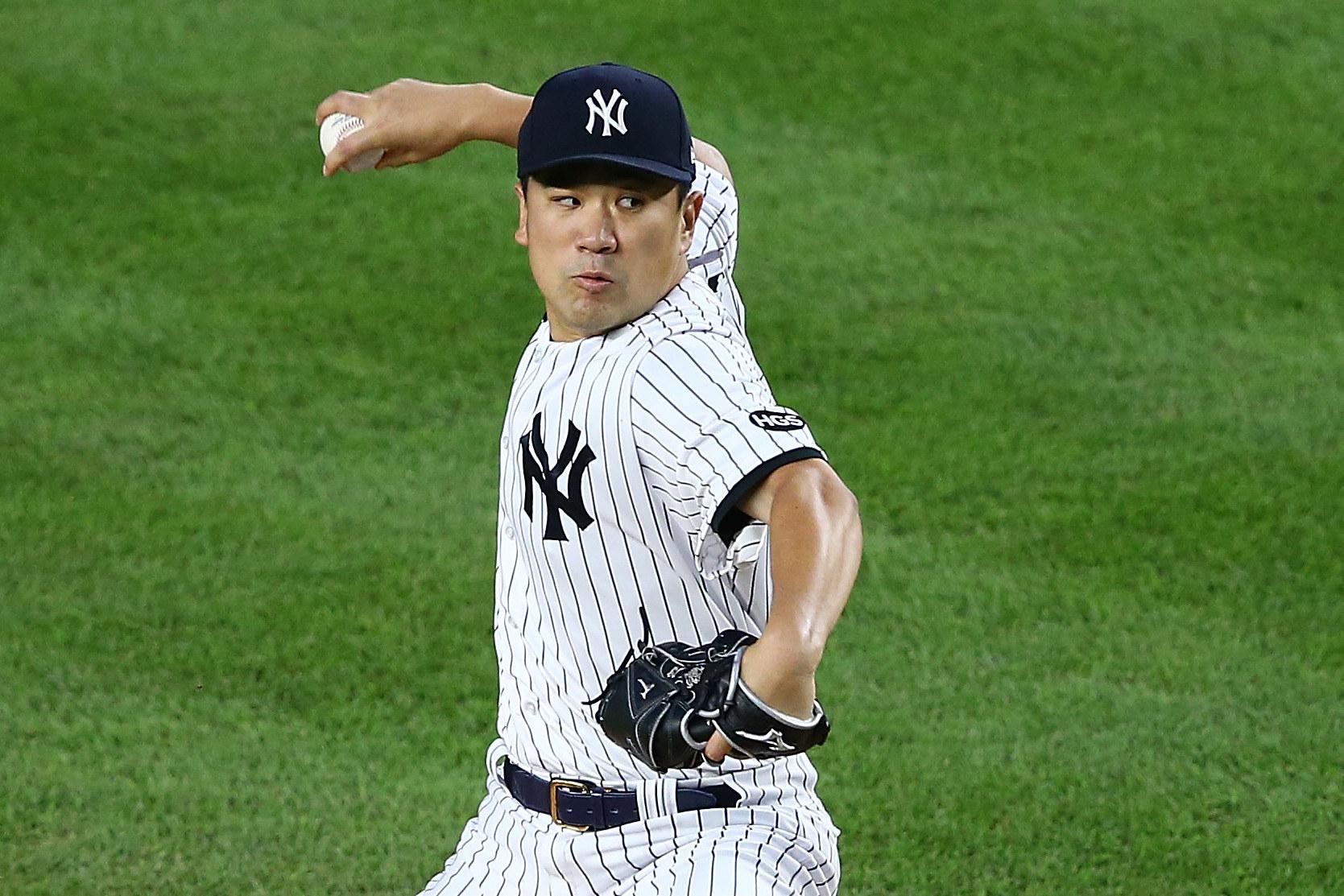 Masahiro Tanaka pitches baseball in a New York Yankees uniform