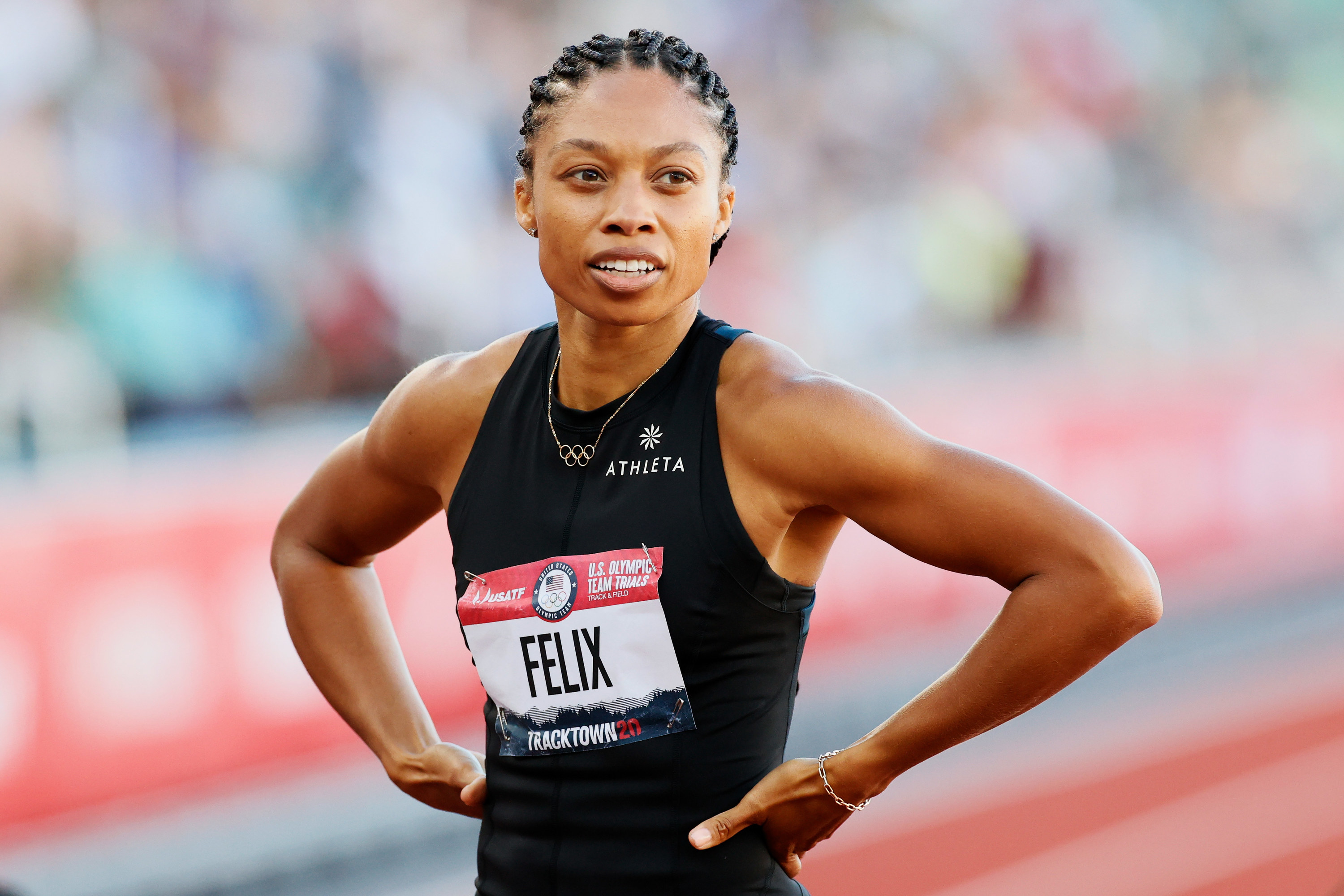 Allyson Felix with her hands on her hips