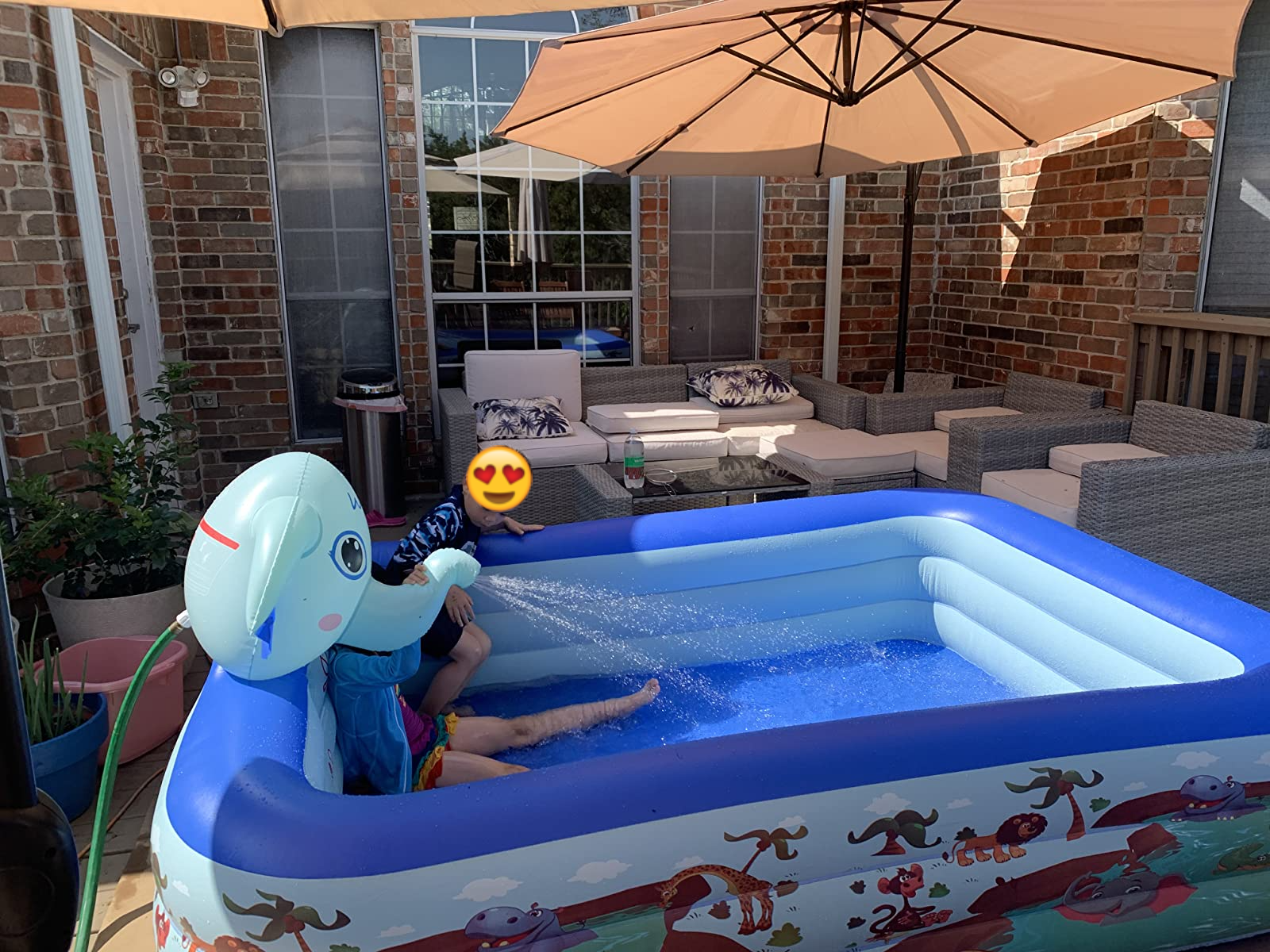 Reviewer's photo showing the kids using the pool in their back patio