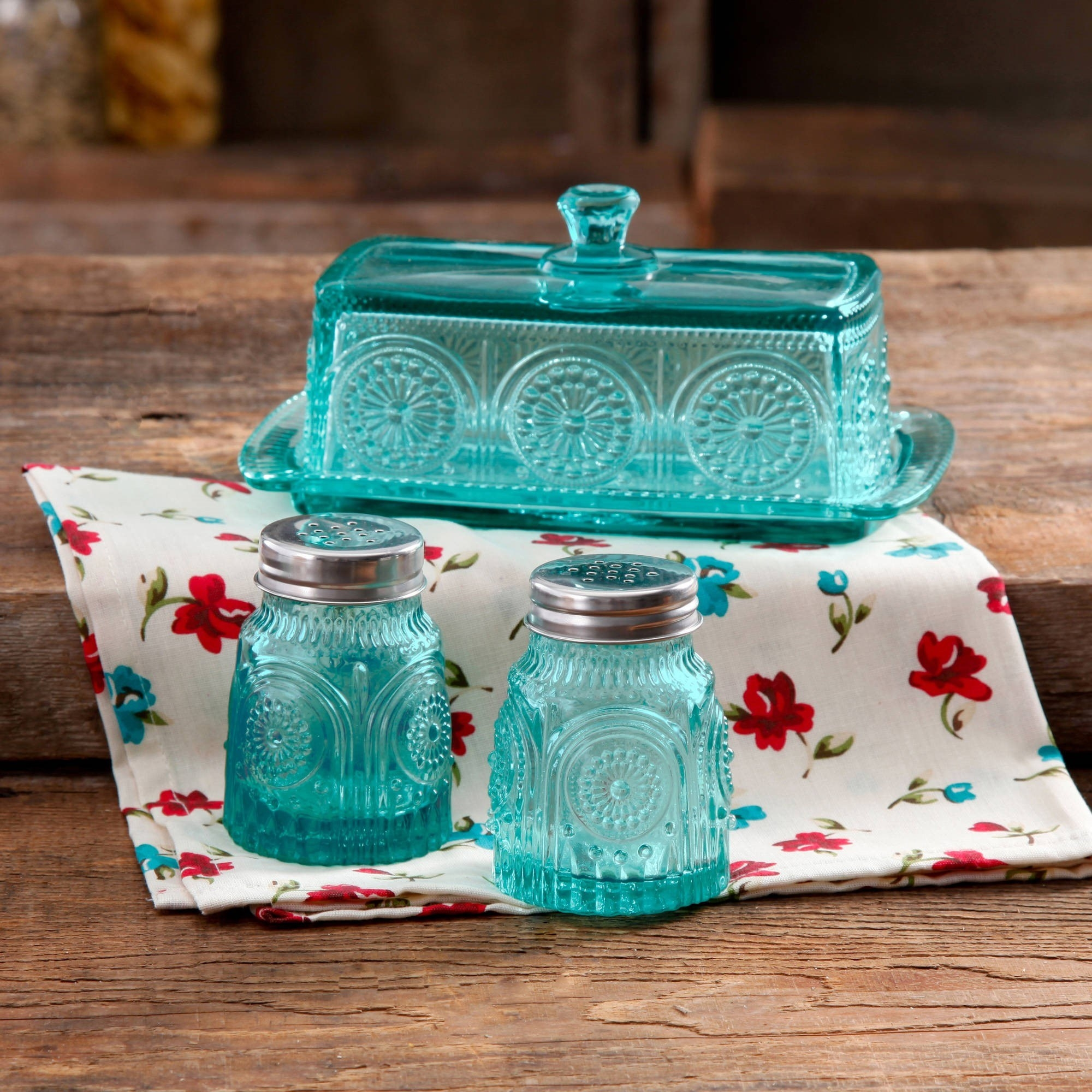 The turquoise glass butter dish, salt and pepper shaker set