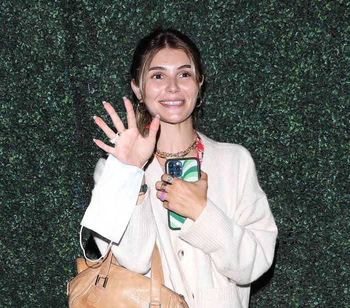 Jade waving at an event