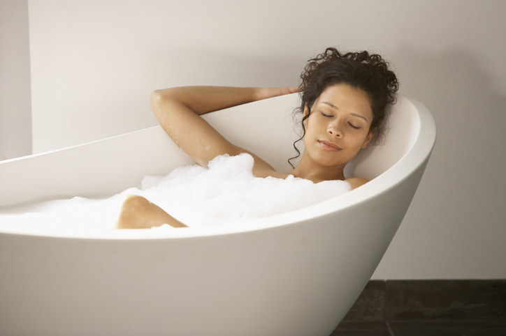A person relaxing in a bubble bath
