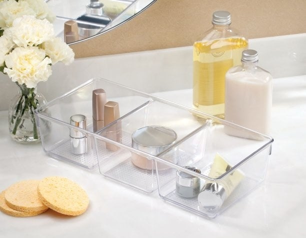The divider holding makeup products
