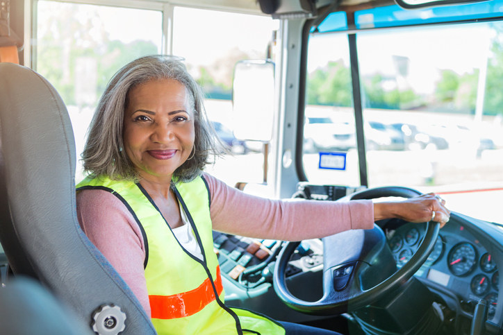 A bus driver smiling