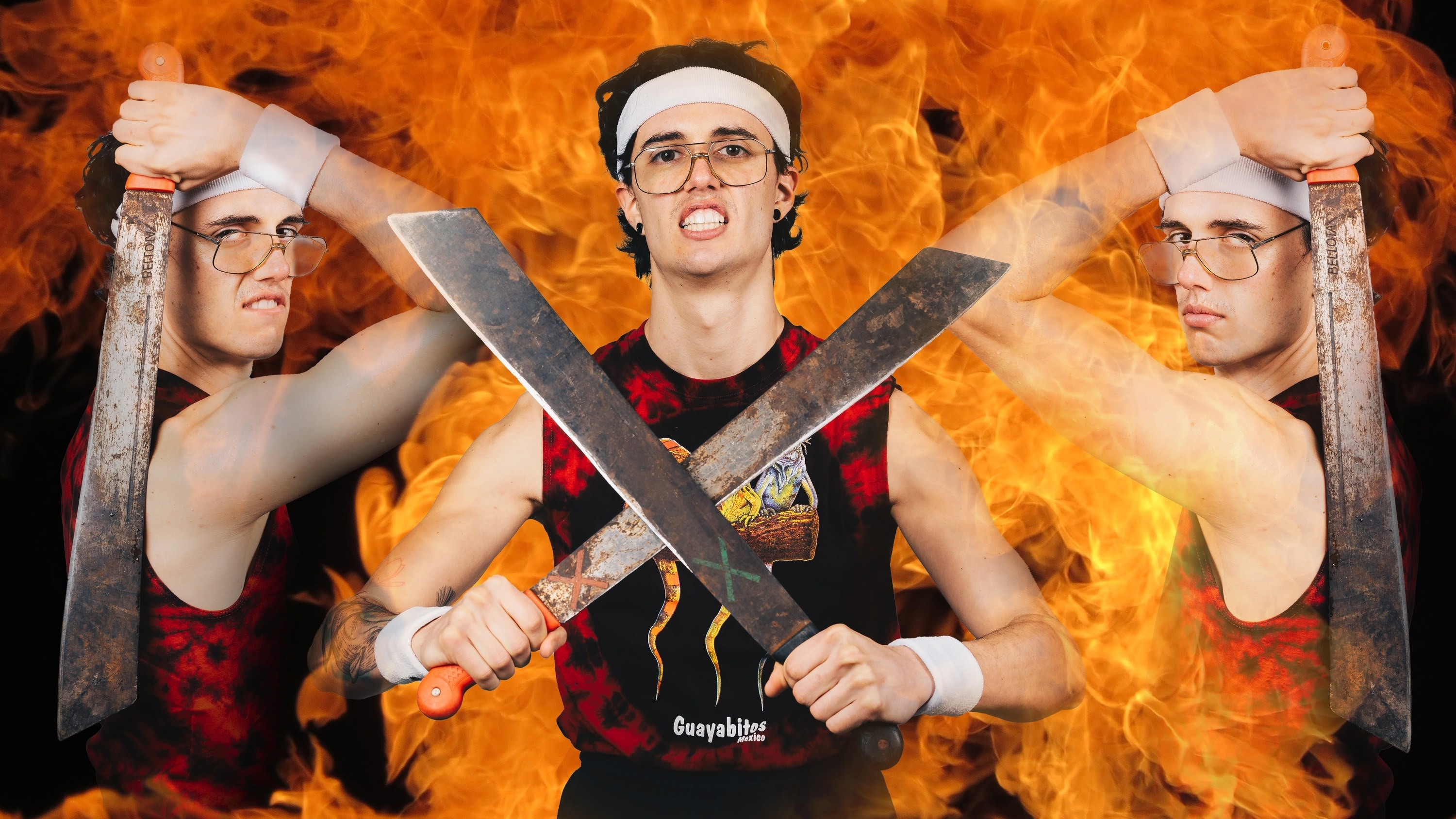 A man dressed in a Monster energy drink tank top is holding katanas with a fire-looking background