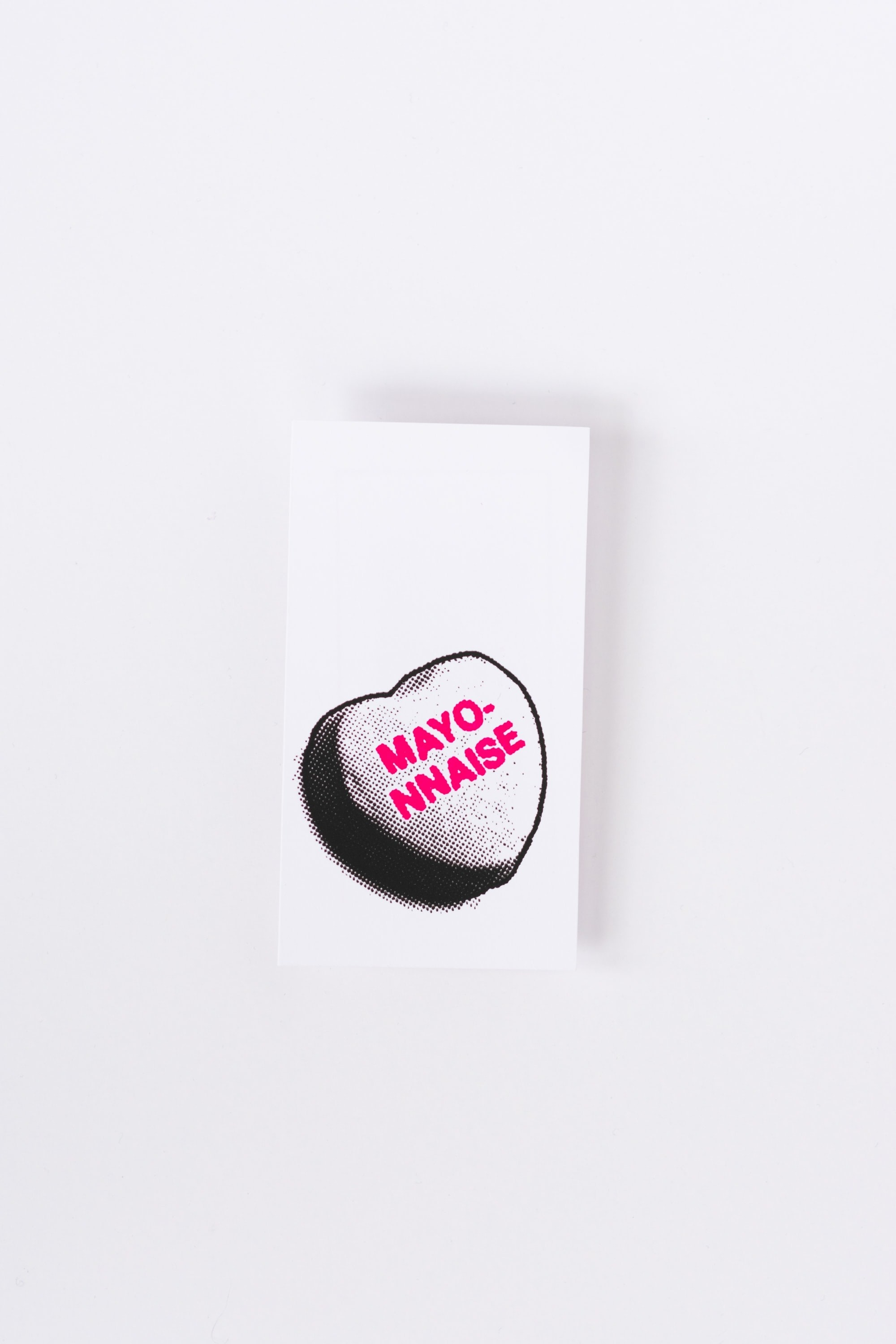 """A black heart on a white background with """"mayo-nnaise"""" written in pink on the center"""