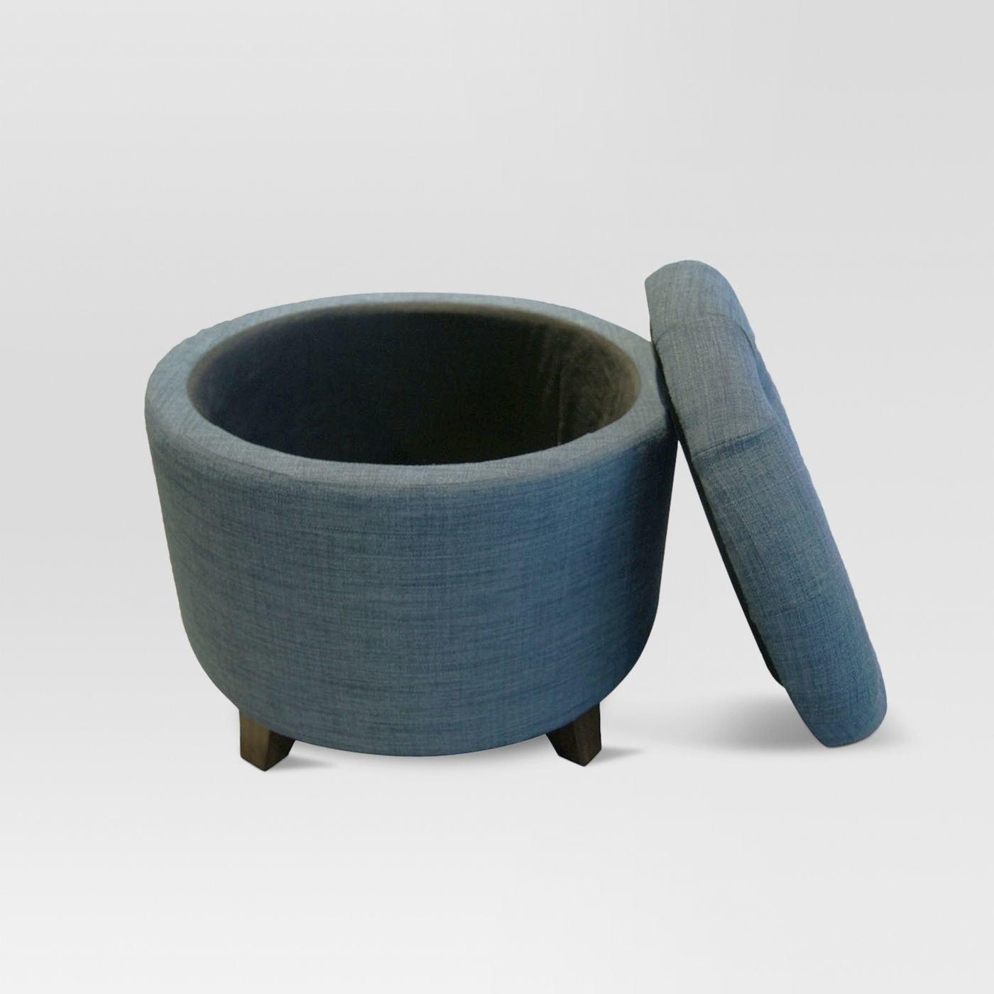 The heathered blue tufted round floor ottoman