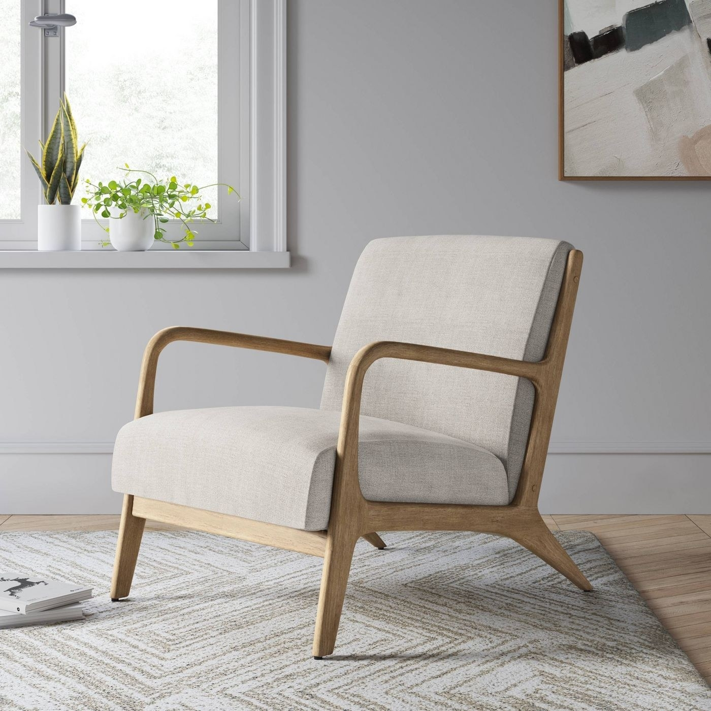The cream/natural wood armchair
