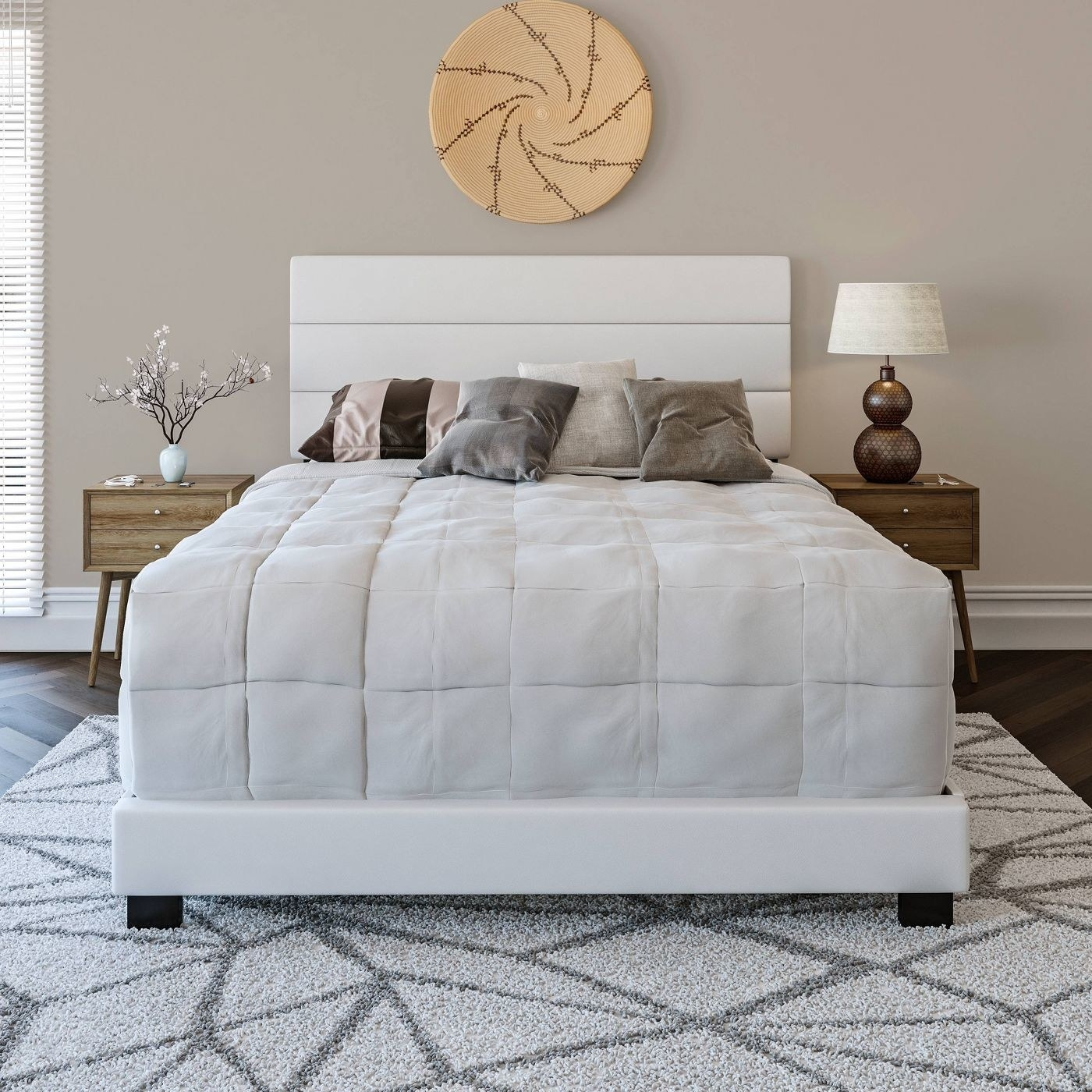 The white faux leather upholstered platform bed