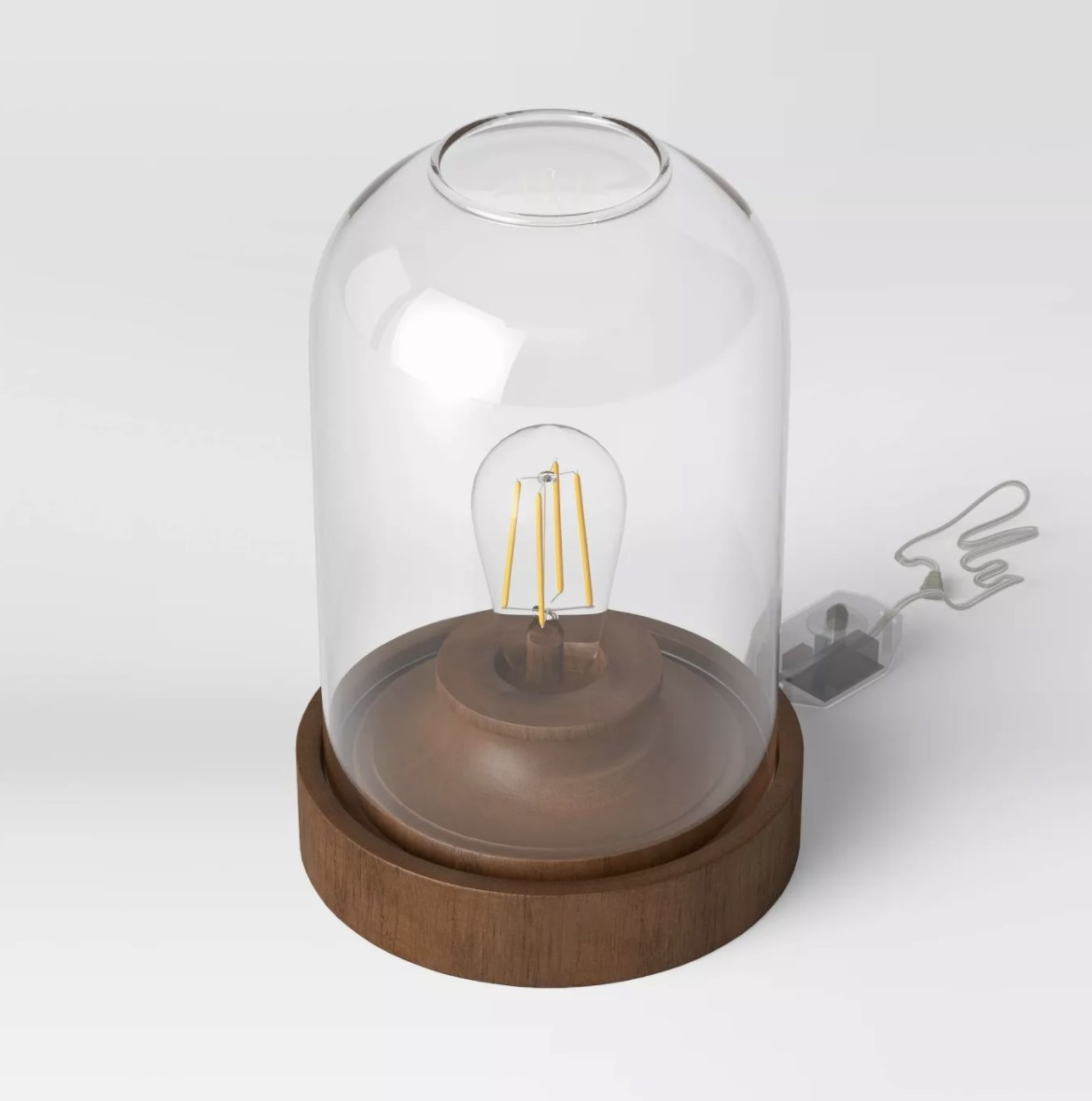 The clear dome base is atop a wooden pedestal