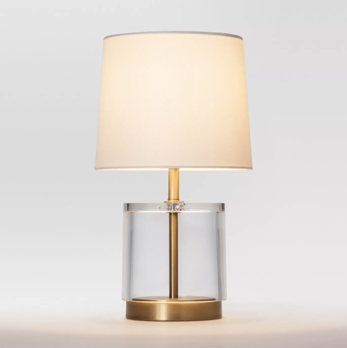 The gold and clear acrylic base make this a statement lamp