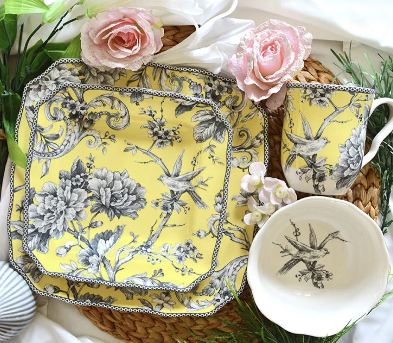 a yellow dish set with grey birds and flowers