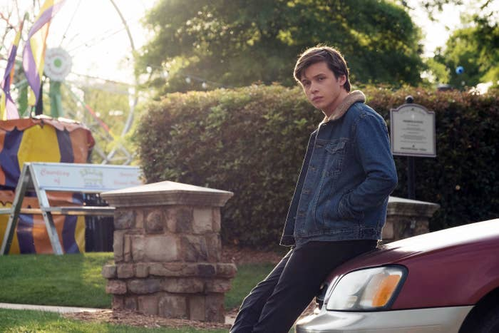 Movie Simon leaning against his car casually
