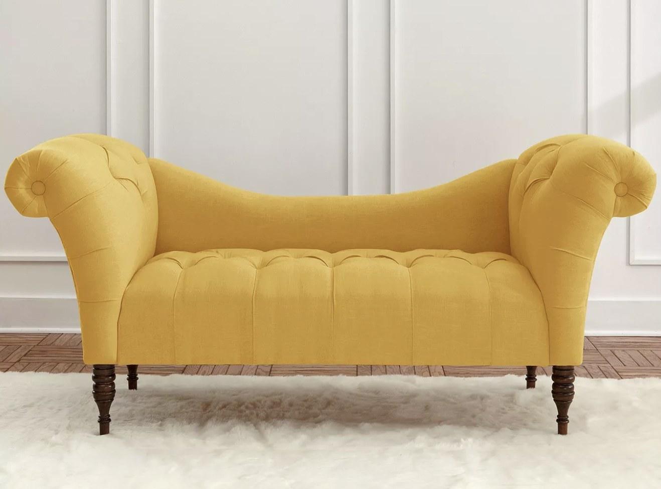 a mustard tuft chaise sofa