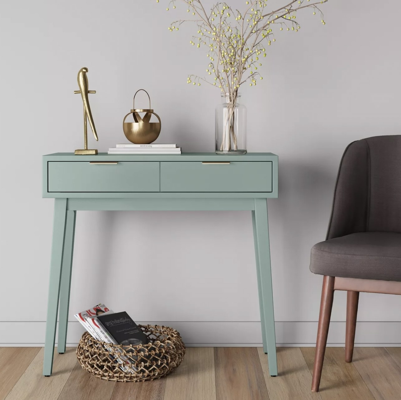 a mint green table with two drawers