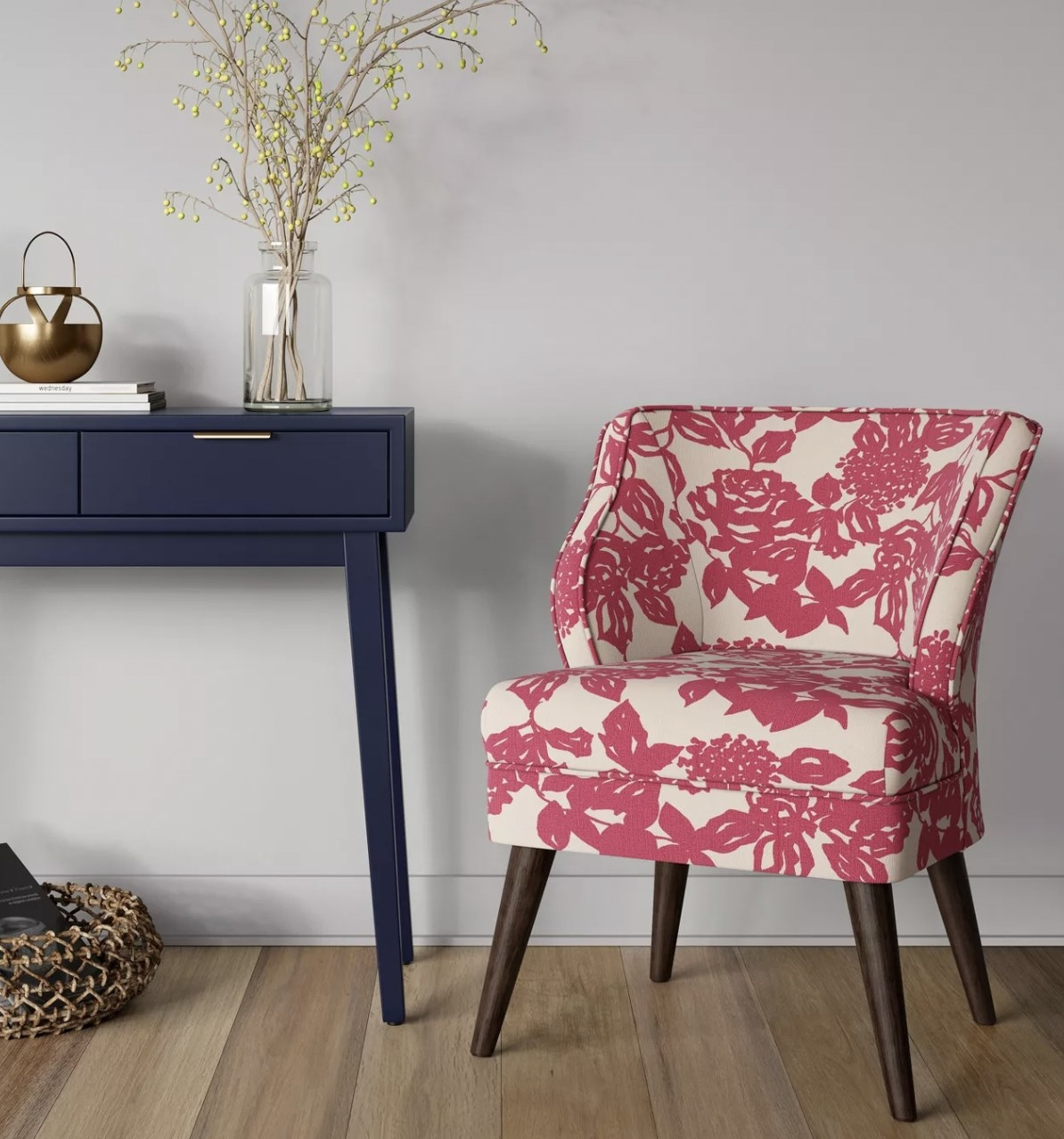 a pink and white floral armchair