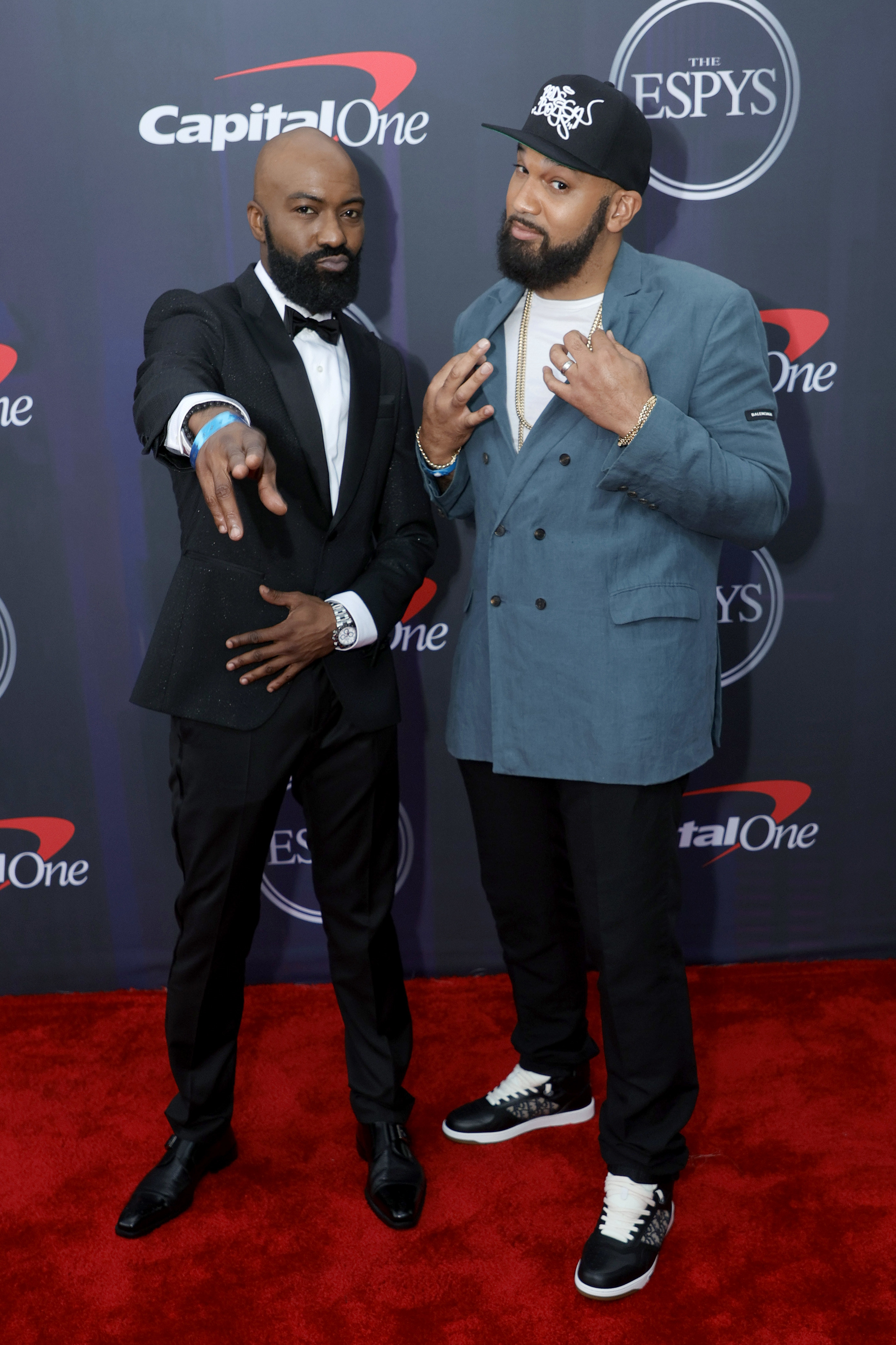 Desus wore a tux and Mero wore a blazer, tee-shirt, slacks, and sneakers