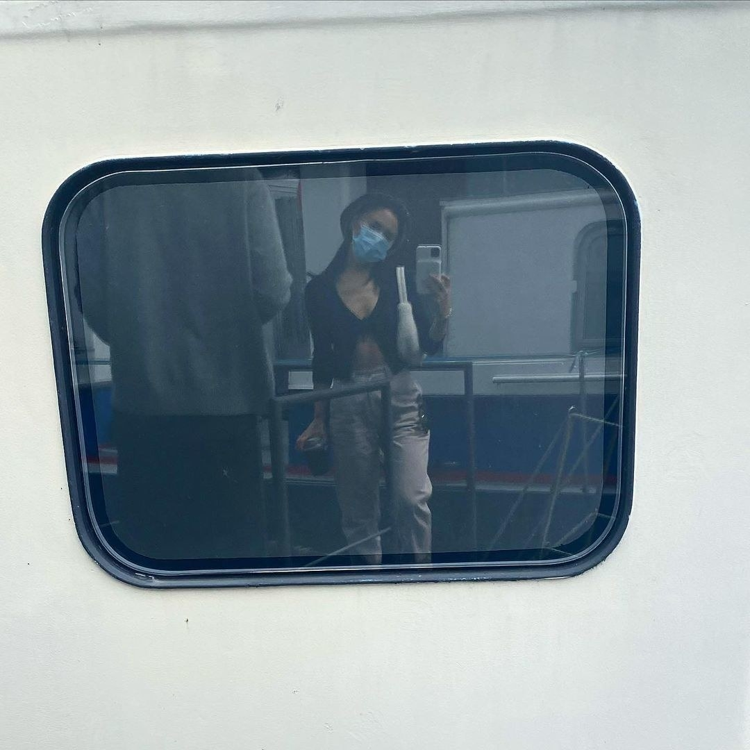 Ariana Grande takes a photo on public transportation in Amsterdam