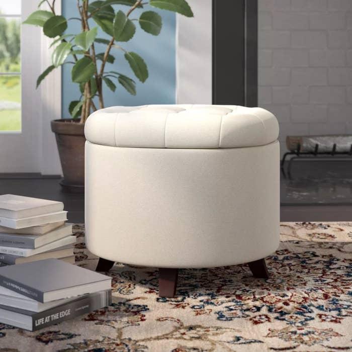 the round ottoman in beige