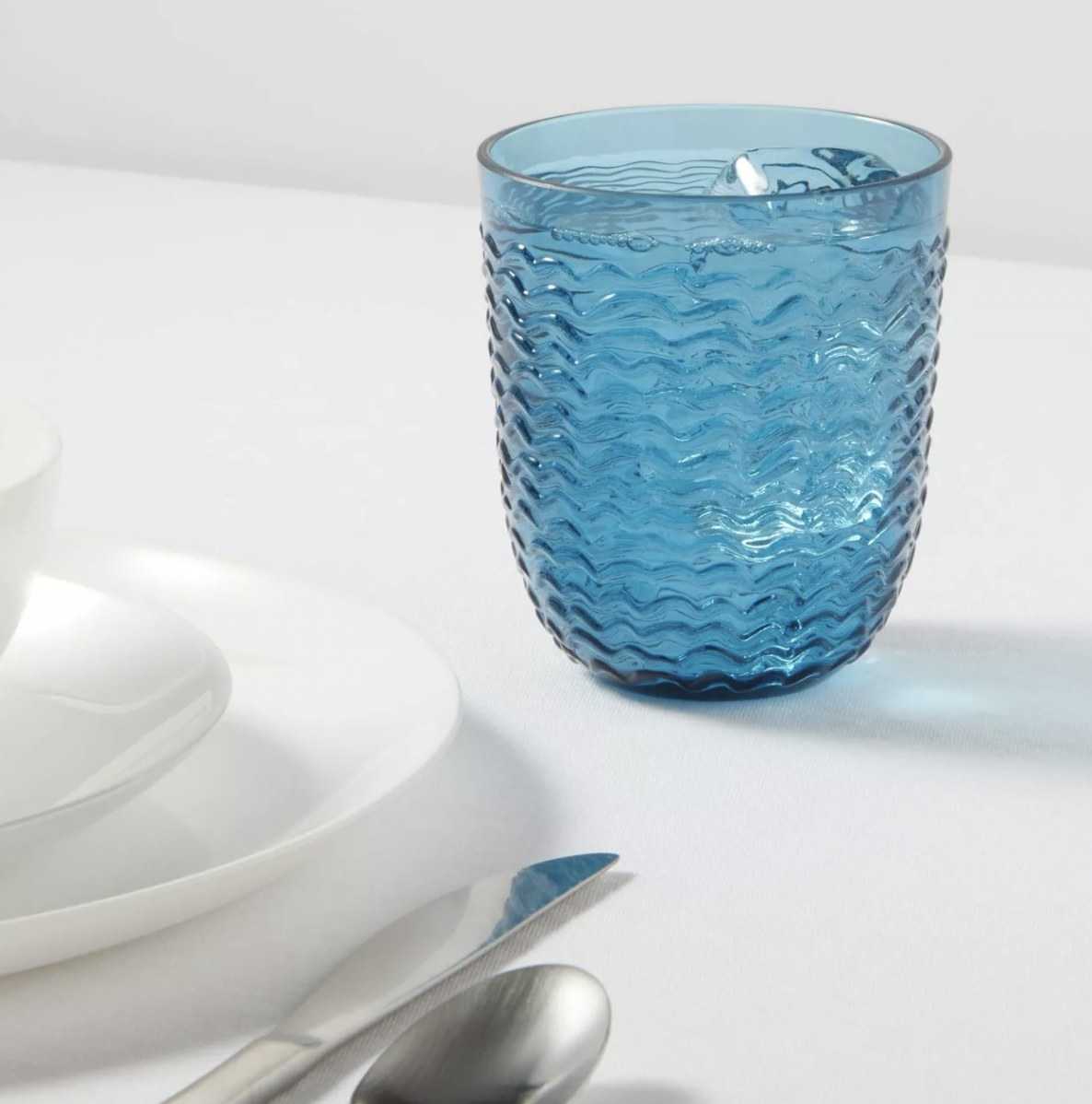 a blue textured tumbler on a table