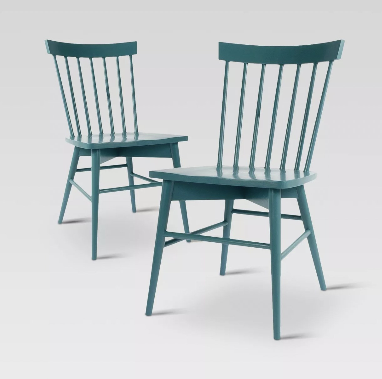 a set of two wooden teal dining chairs