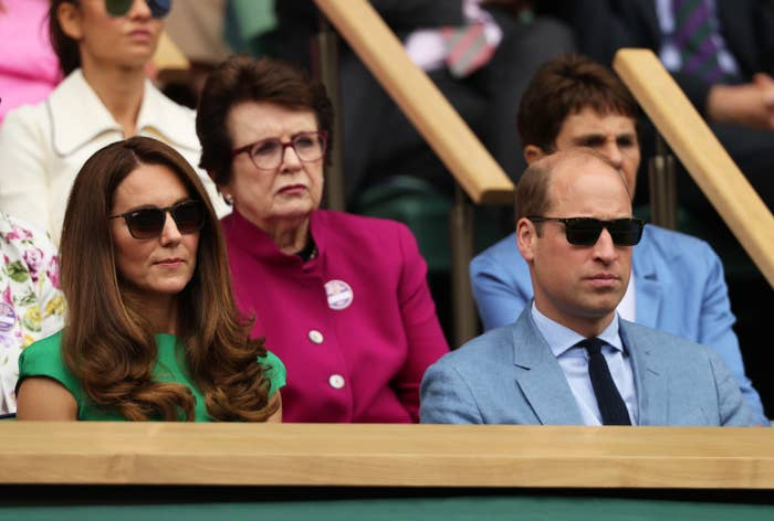 Kate and William wearing sunglasses in the stands