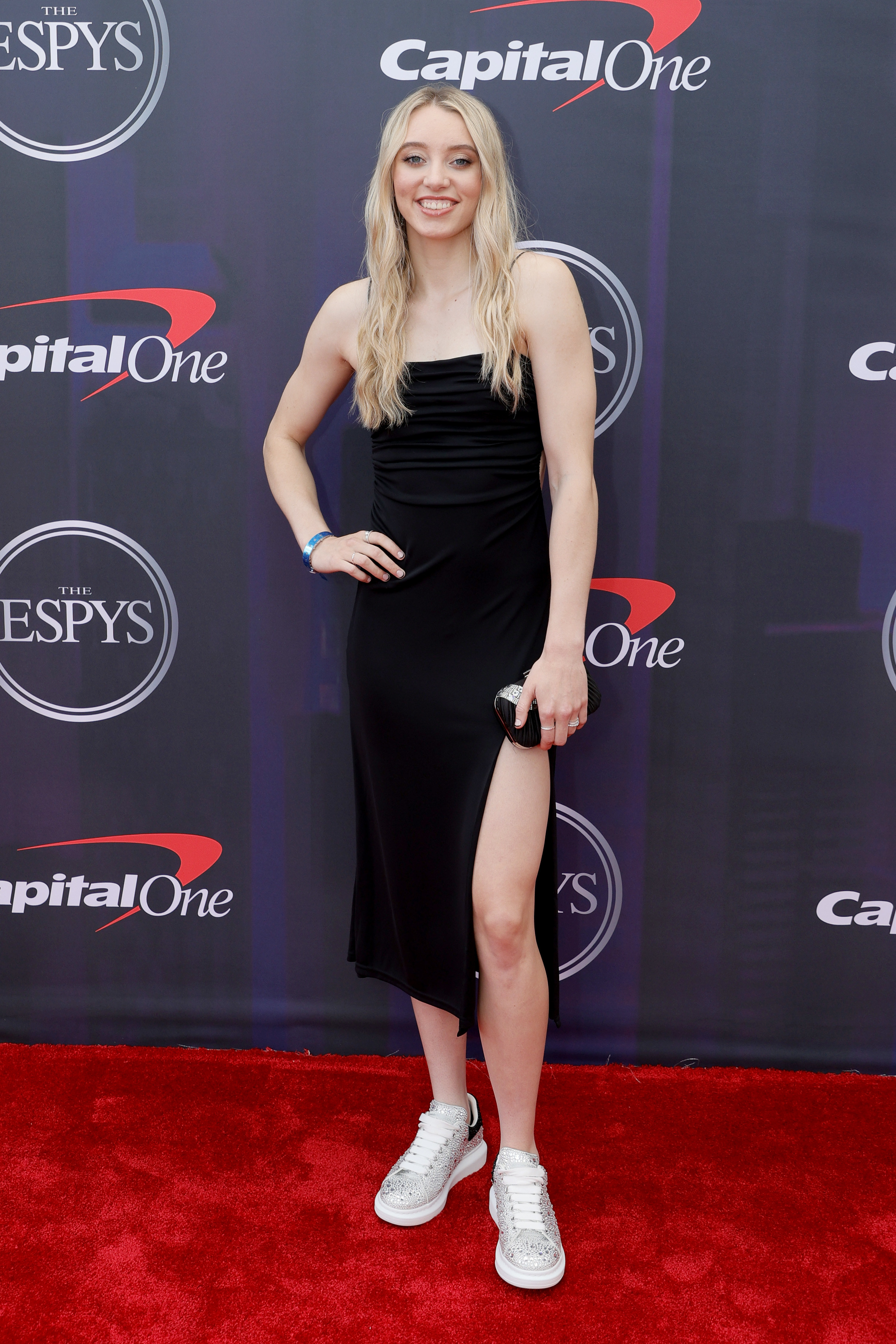Paige wore a simple knee-length dress and sneakers