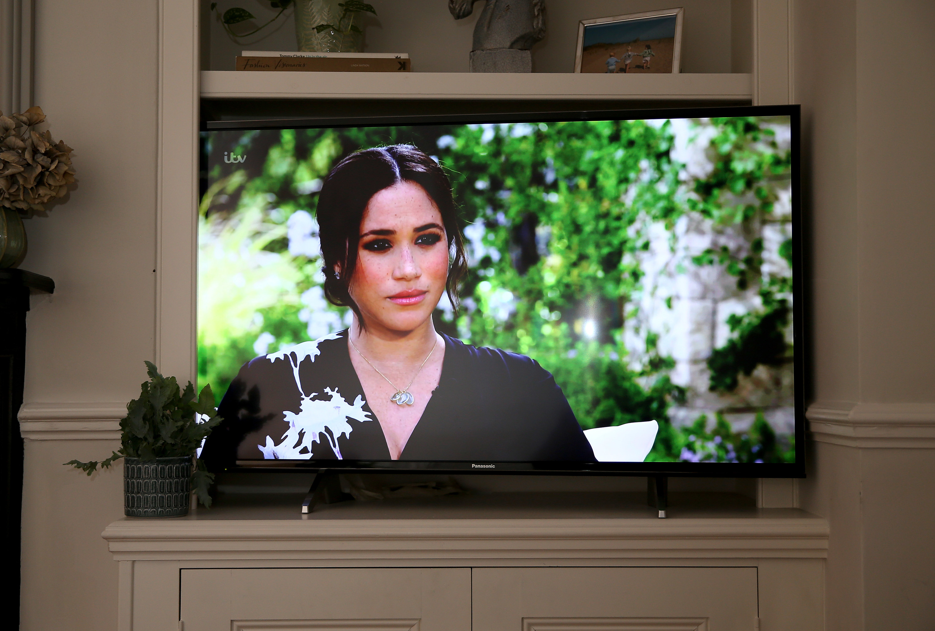 Meghan shown on a TV screen during her interview