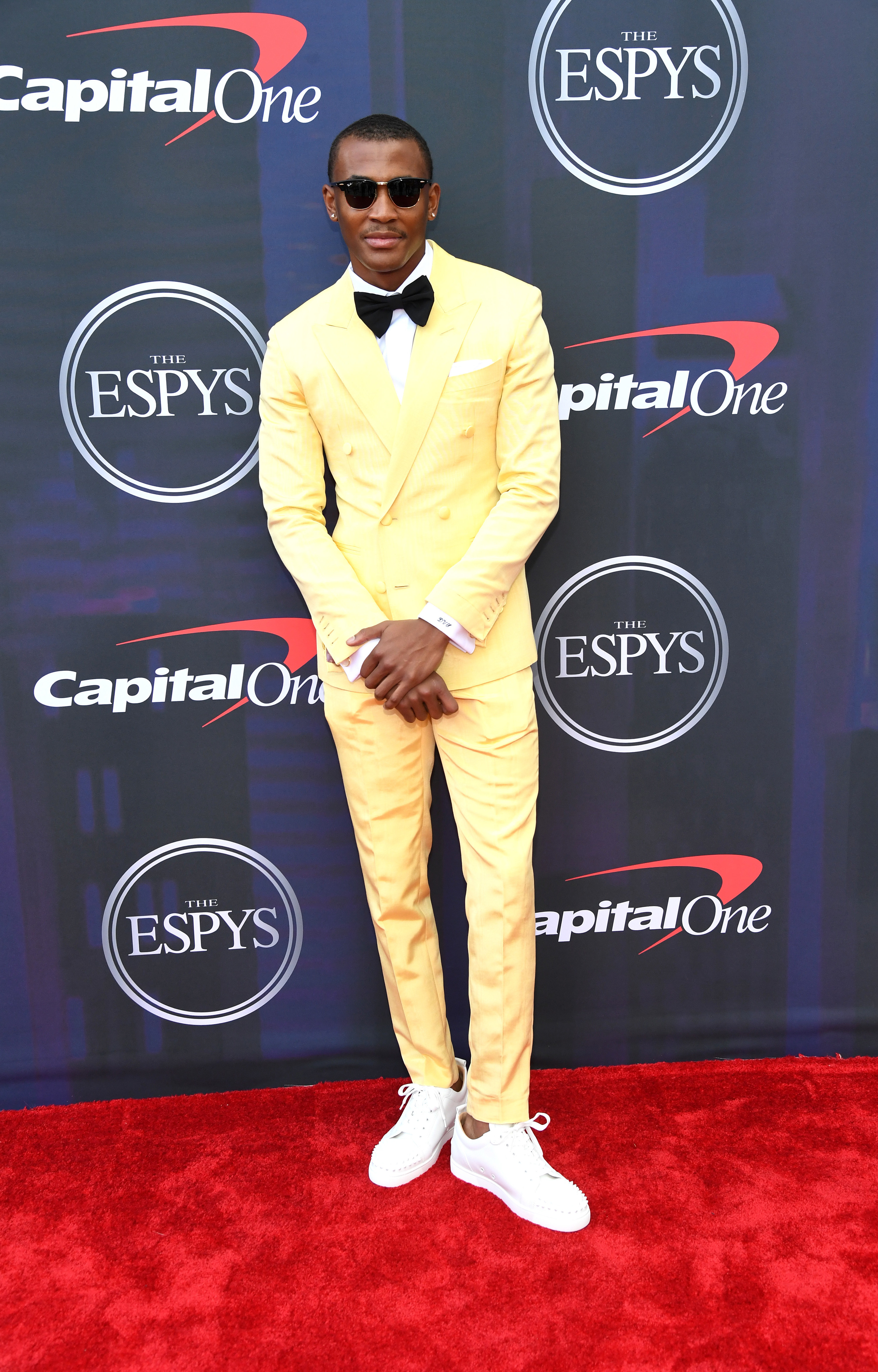 Devonta wore a canary yellow tux and sneakers