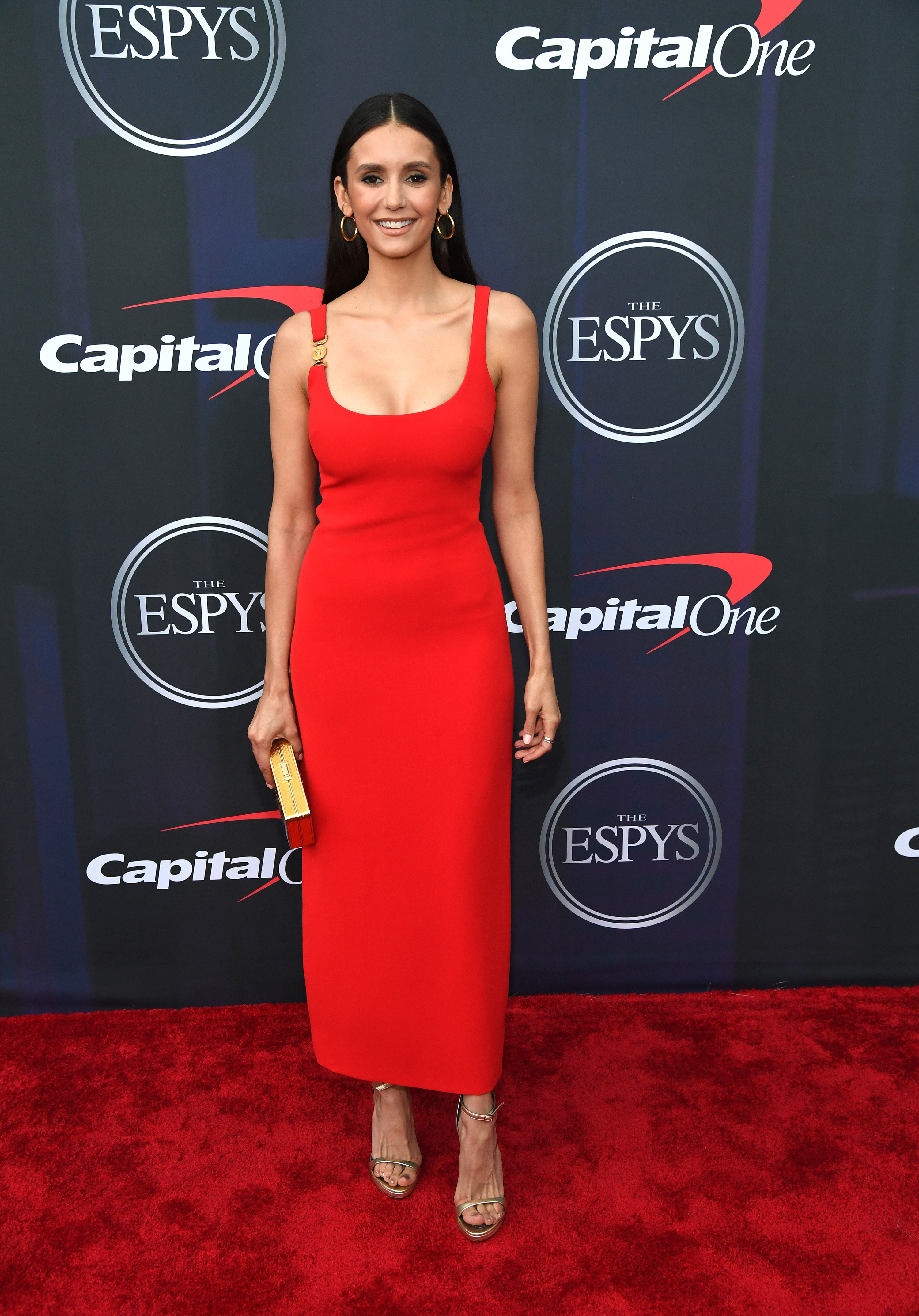 Nina wore a simple ankle-length gown with a clasp detail on one shoulder