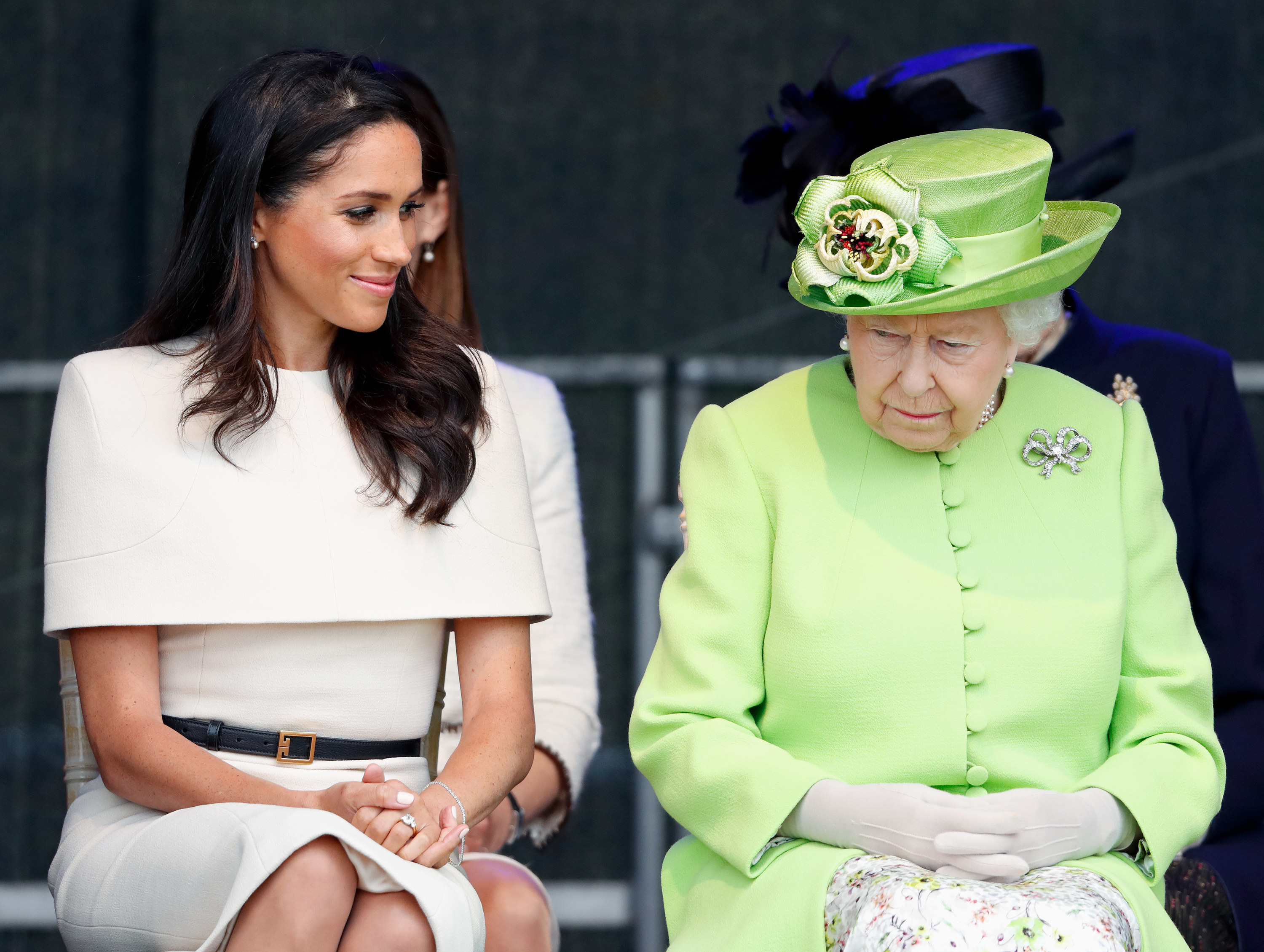 Meghan and Queen Elizabeth sitting next to each other
