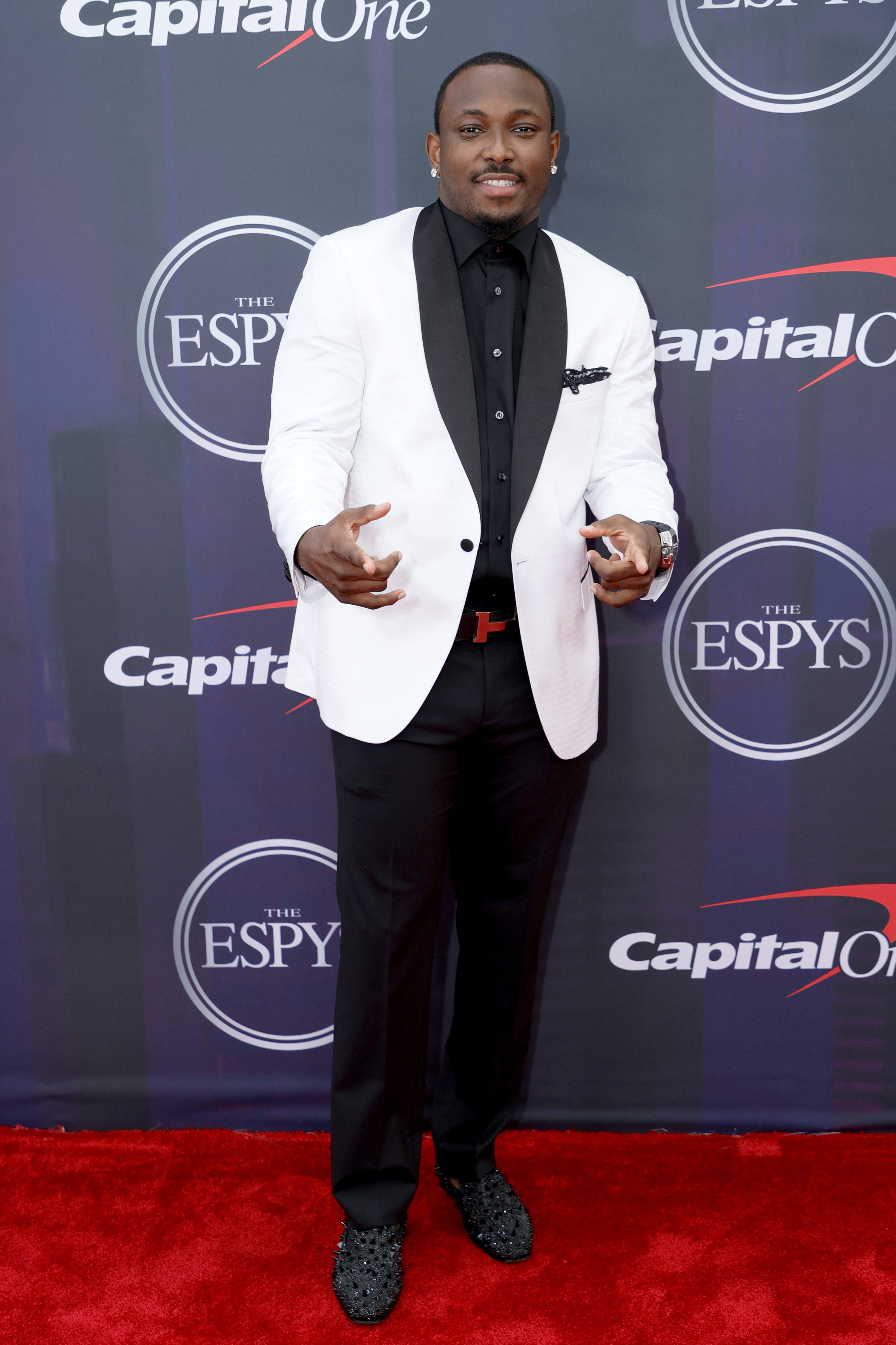 LeSean wore a two-toned suit and bedazzled shoes