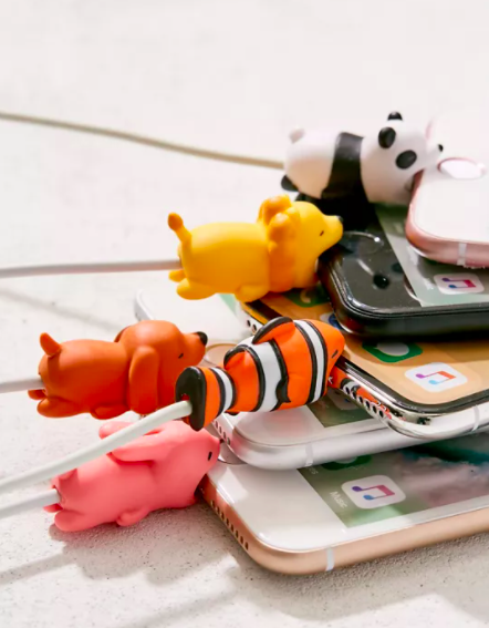 A set of animal-shaped cable clips attached to charging cables