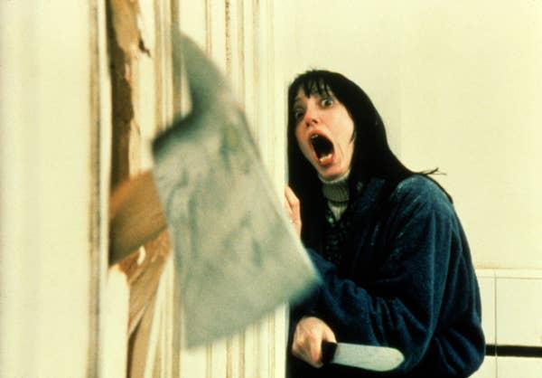 Wendy screaming as Jack breaks through the bathroom door with an axe