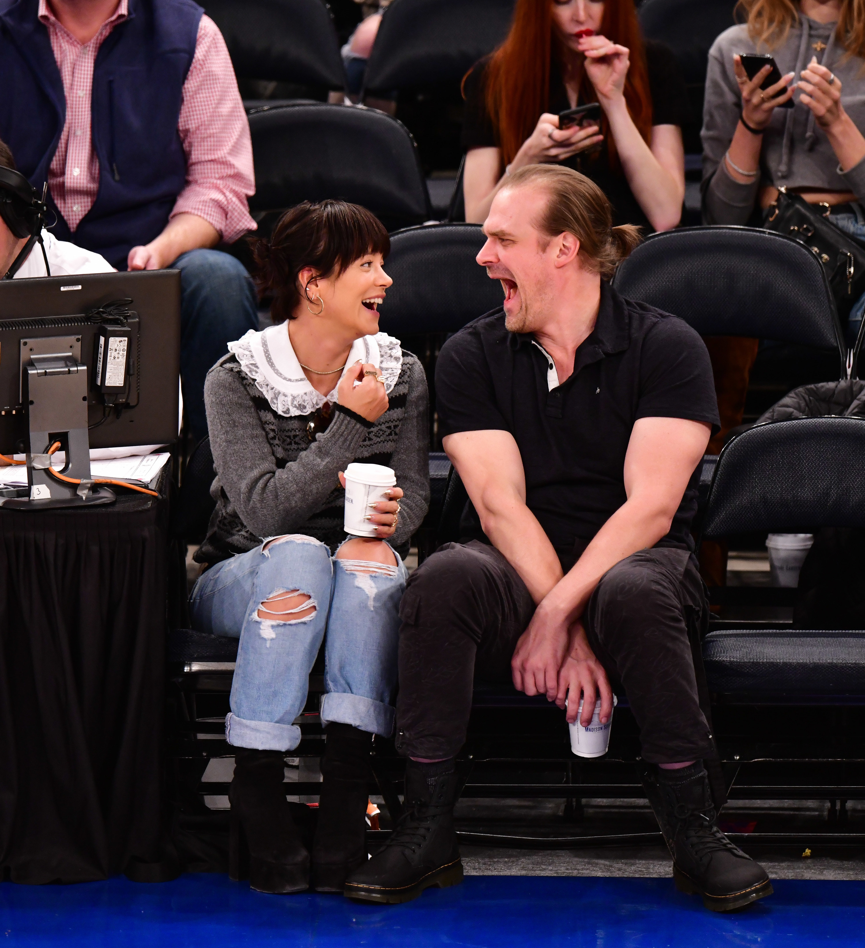 Lily Allen and David Harbour casually dressed at a sports event