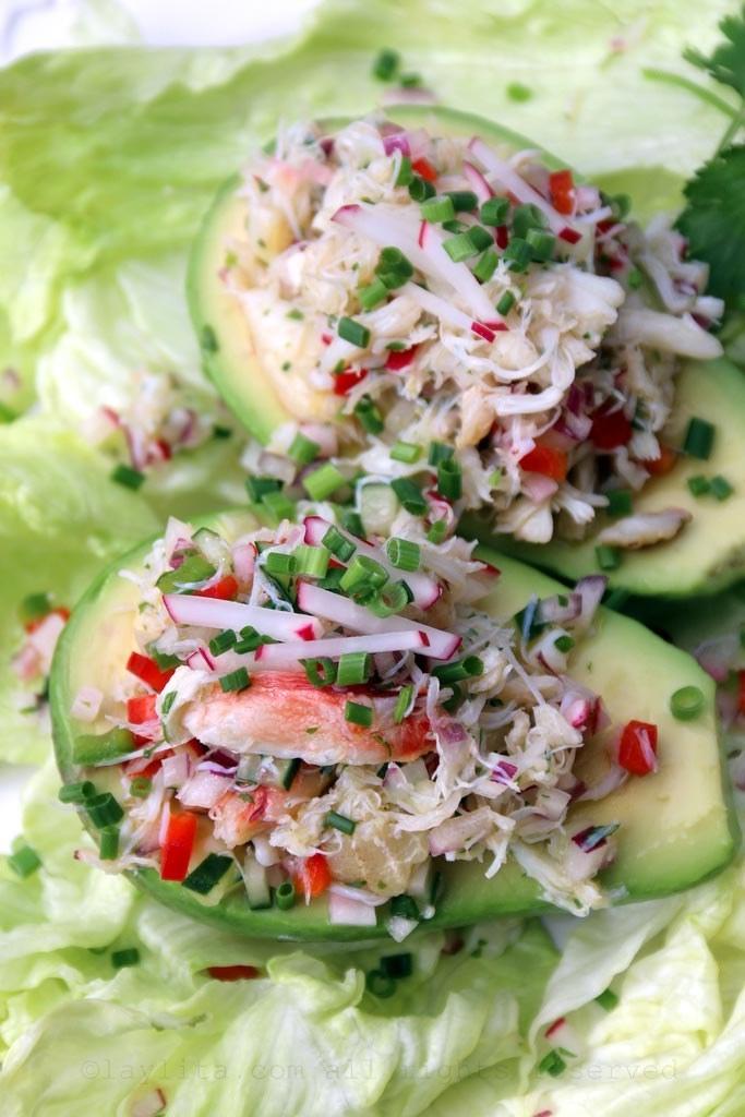 Avocado stuffed with crab salad.