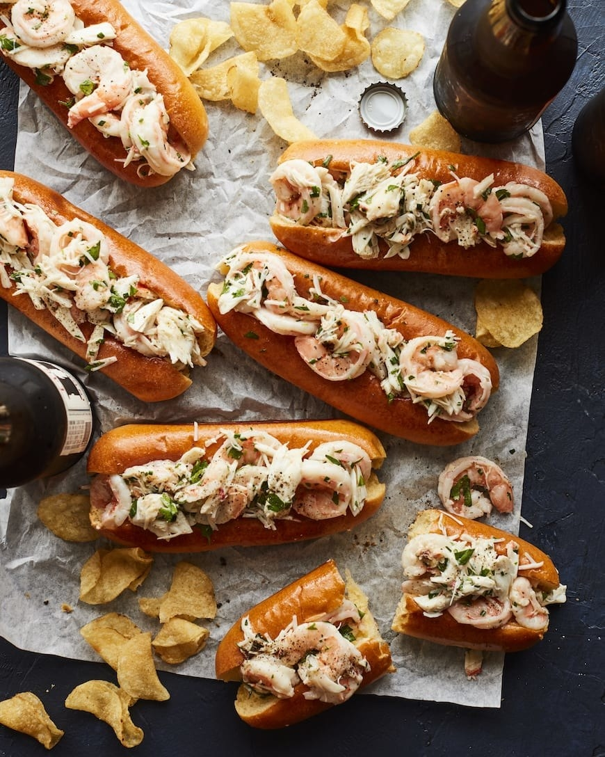 Crab and shrimp rolls with potato chips.