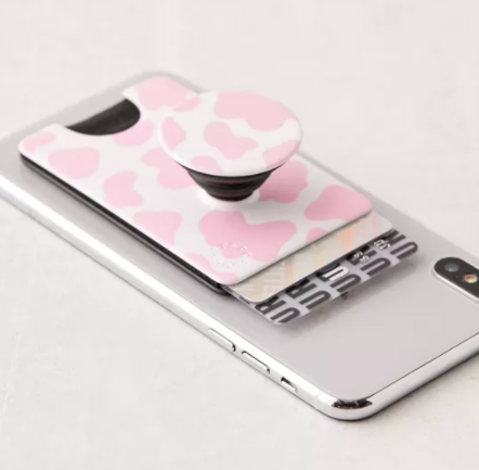 A slim wallet sleeve on a phone with an attached popsocket phone stand