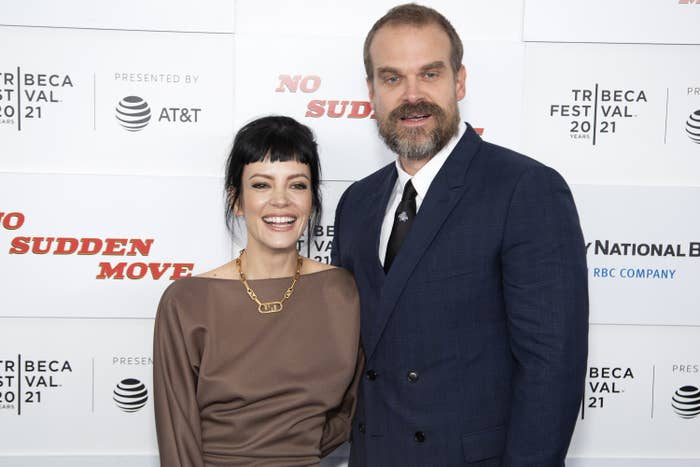 Lily Allen and David Harbour smiling and standing close together on the red carpet