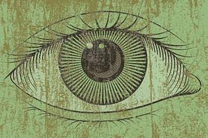 an eye on a green wooden board