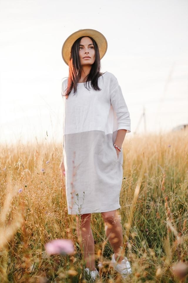 model wearing a gray and white linen dress