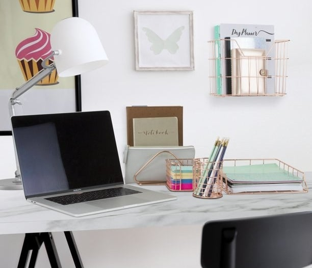 All 5 of the pieces in the set in use in a home office