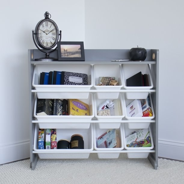 The shelf in gray holding miscellaneous items